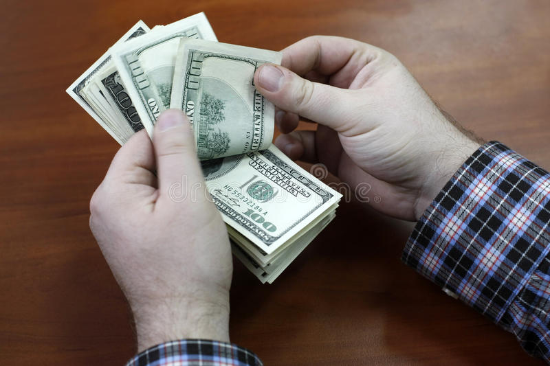 Person counting money stock images