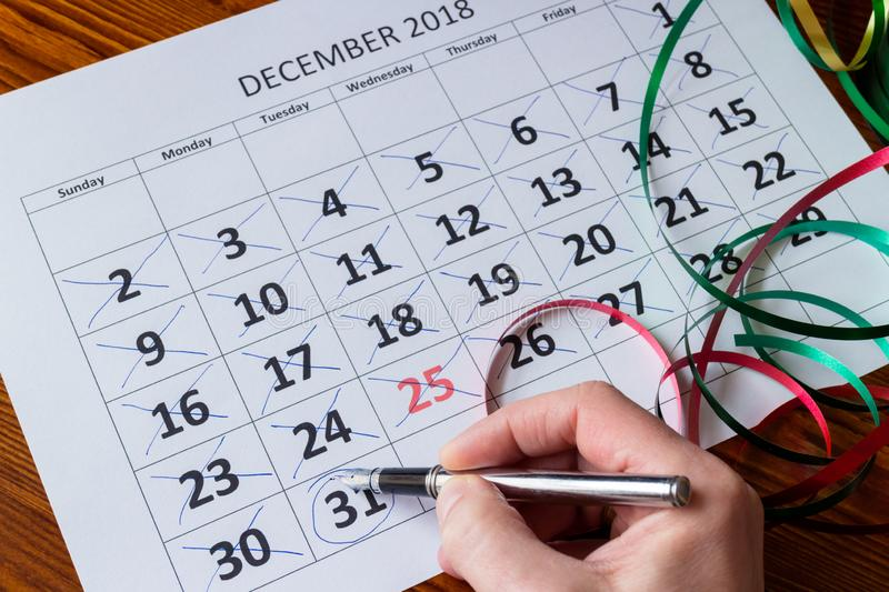 Person crossed all days of December stock photos