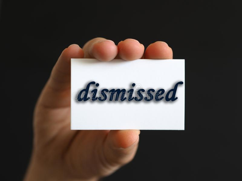 Person with a dismissed card in hand or note paper stock images