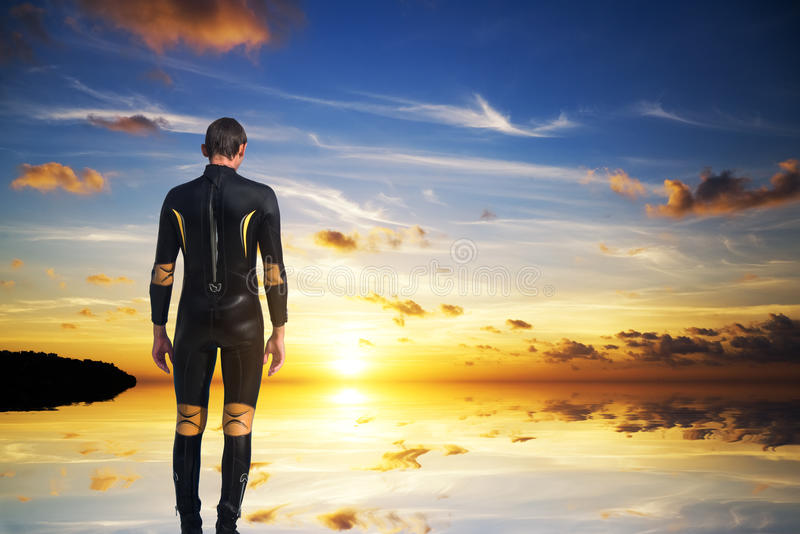The person in a diving suit royalty free stock photos