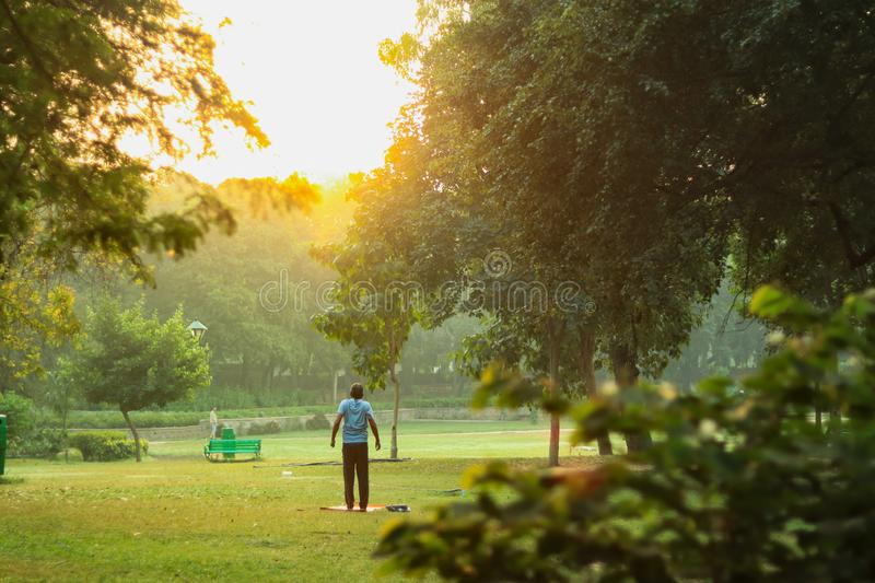 A person doing exercise in front of sunrise royalty free stock image