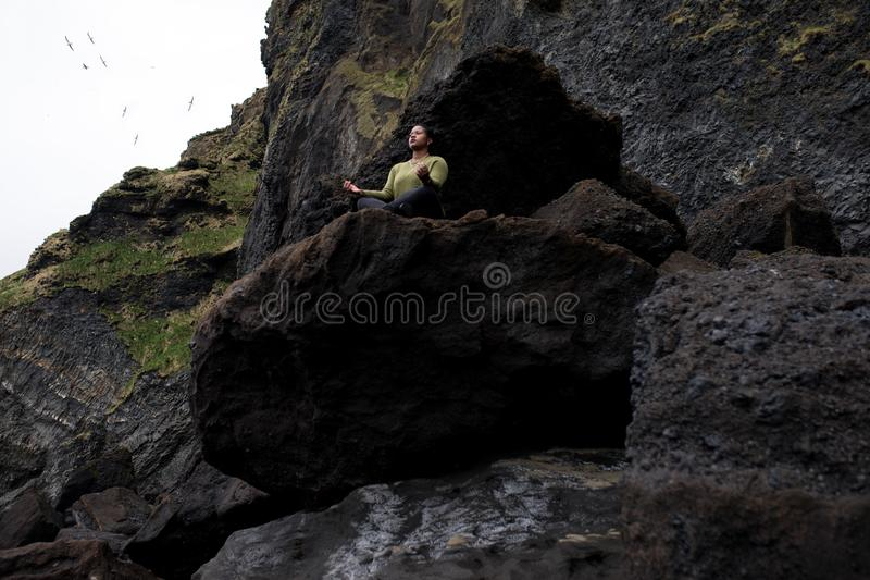 Person Doing Yoga on Rocky Mountain royalty free stock images