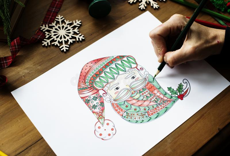 Person Drawing Gnome on White Printer Paper royalty free stock photography