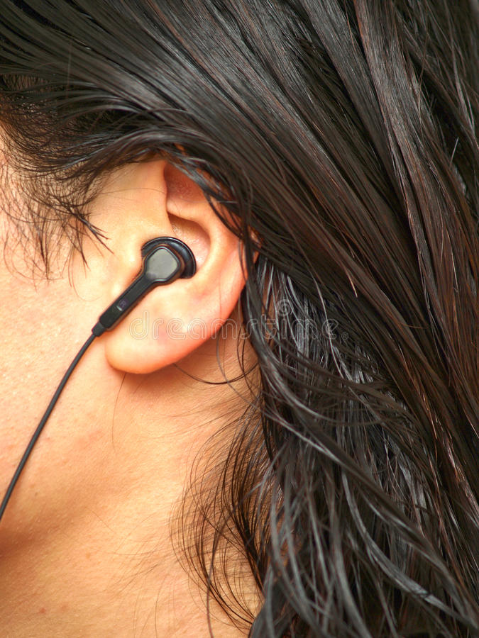 Download Person with ear plug stock photo. Image of headphone - 11541716