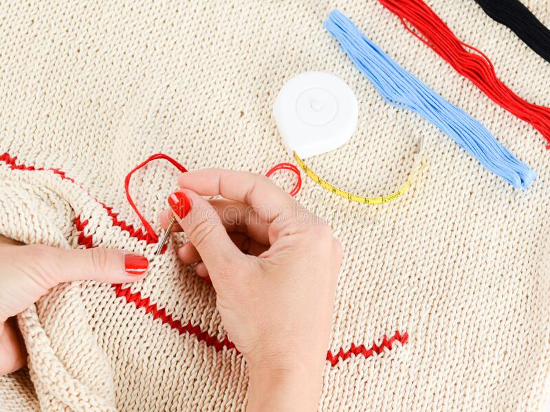 Person Embroidering A Beige Textile Free Public Domain Cc0 Image