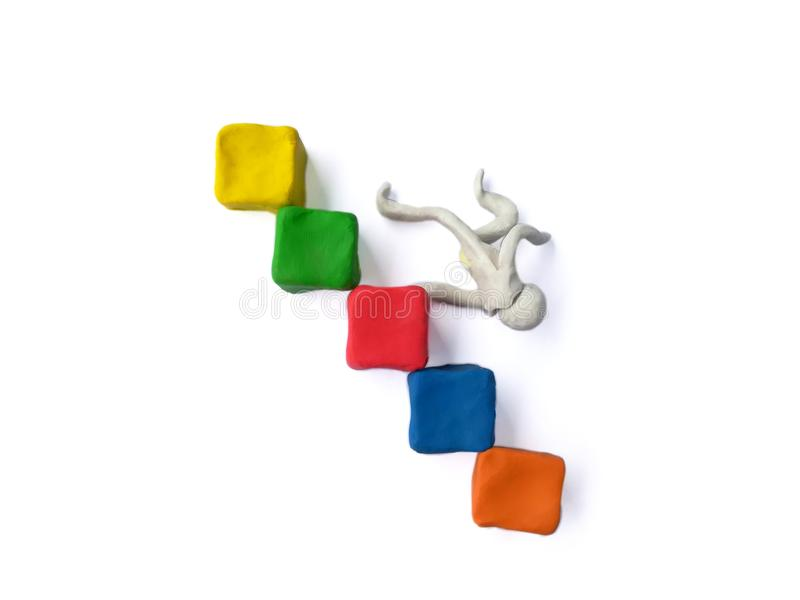 Person falling down plasticine clay, block staircase dough, mistakes business. Plasticine clay made blocks stacked staircase, person falling down the stairs, on royalty free stock photography
