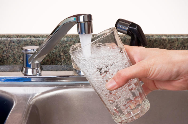 Download Person Filling Glass From Tap Stock Photo - Image: 9504168
