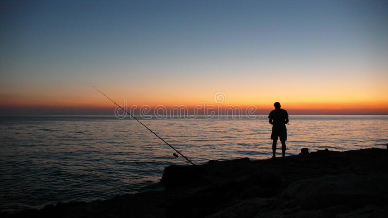 Person Fishing During Sunset Free Public Domain Cc0 Image