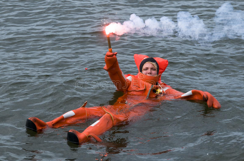 Download Person Floating In Survival Suit Holding Red Handflare Editorial Image - Image: 29798515