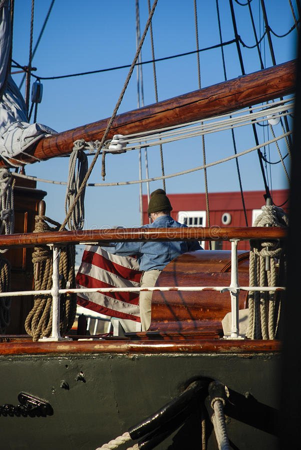 Download Person Folding Flag On Ship Stock Image - Image of flag, folding: 55337821