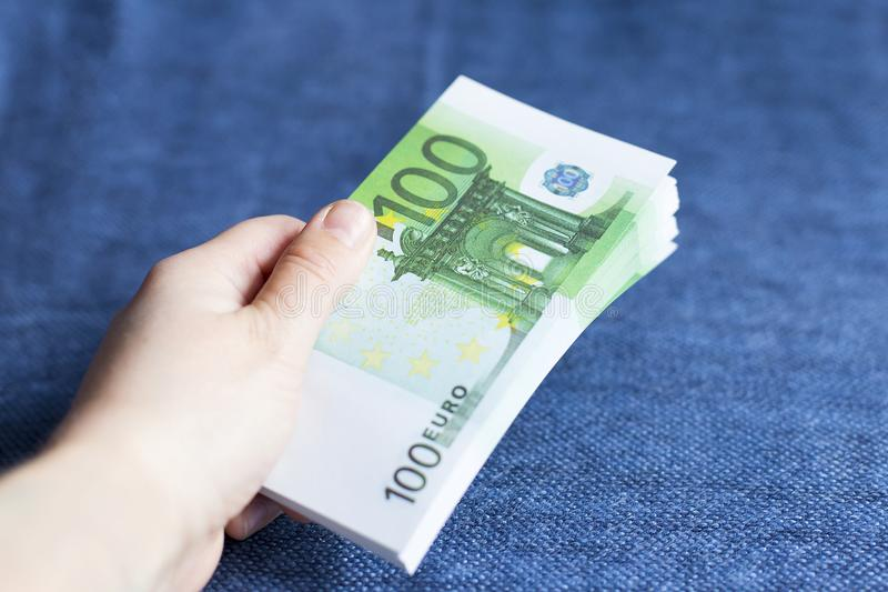 Person gives a pack of Euro currency royalty free stock images