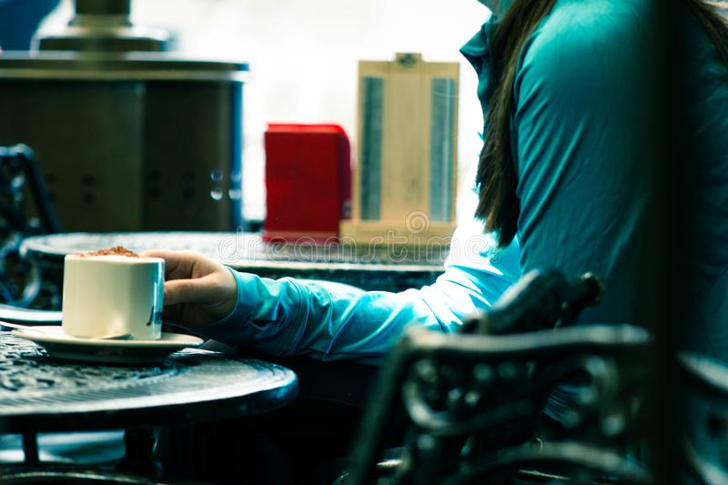 Person In Green Long-sleeved Top Sitting On Chair White Holding White Ceramic Mug Free Public Domain Cc0 Image
