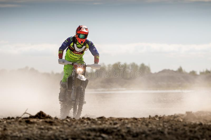 Person In Green Motocross Gear Riding A Dirt Bike stock images