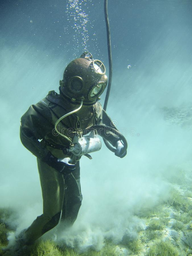 Person in Green Scuba Diving Suit stock image