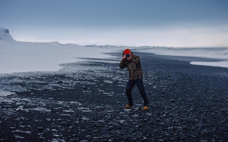 Person In Grey Jacket And Blue Denim Jeans Tacking A Photo In A Snowy Field During Daytime Free Public Domain Cc0 Image