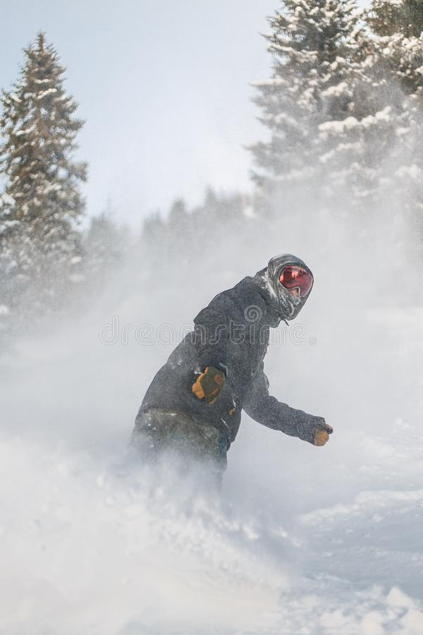 Person in Grey Jacket and Red Snow Goggles Riding on Snowboard royalty free stock photography