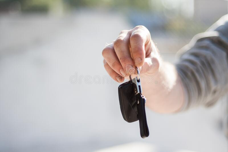 Person In Grey Shirt Handing Keys Free Public Domain Cc0 Image