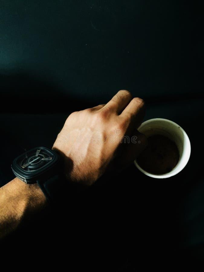 Person Hand en Cup royalty-vrije stock foto