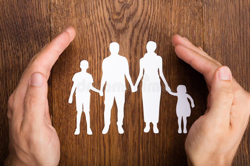 Person Hand Protecting Family Papercut royalty free stock image