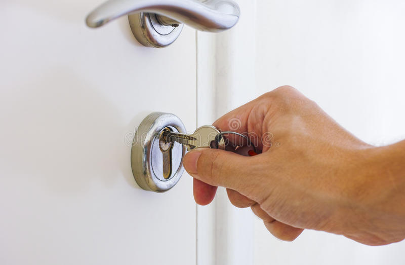 Human hand ready to open door by key stock photos