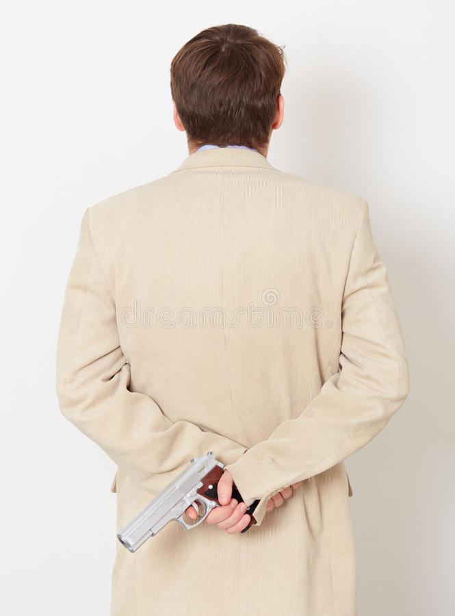Download Person Hides Behind Back Weapon - Rear View Stock Photo - Image: 12598084
