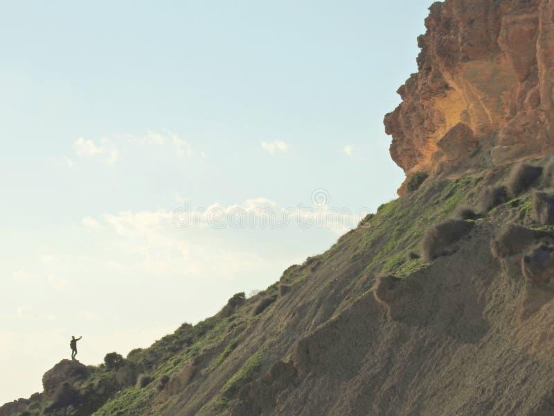 Person on High Rocky Ridge Summit Selfie. Lone person on a rocky ridge taking a selfie royalty free stock photo