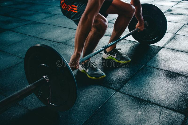 Person Holding Barbell stock photography