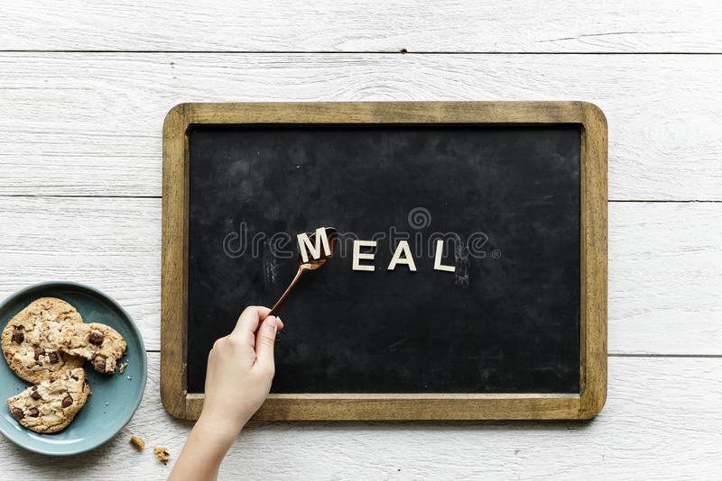 Person Holding Black and Brown Food Tray stock photography
