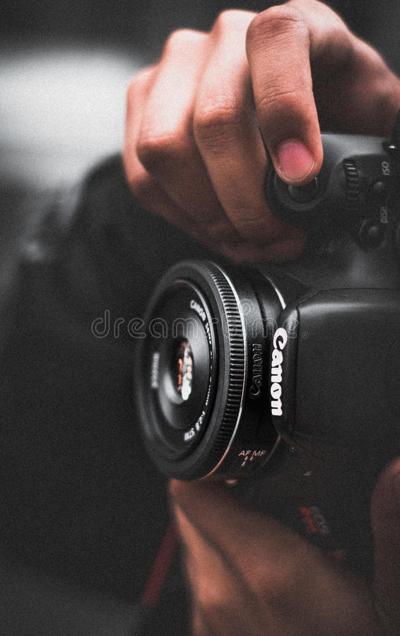Person Holding Black Canon Dslr Camera Shallow Focus Photography royalty free stock photography