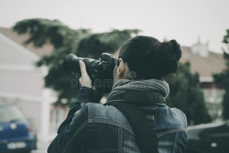 Person Holding Black Dslr Camera Wearing Blue Denim Jacket Free Public Domain Cc0 Image