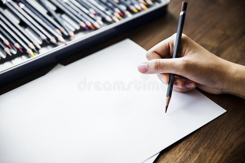 Person Holding Black Pencil royalty free stock photos