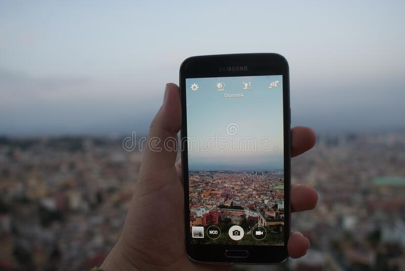 Public Domain Image Person Holding A Black Samsung Galaxy Android Smartphone Taking A Picture Of Cityscape Over Blue And