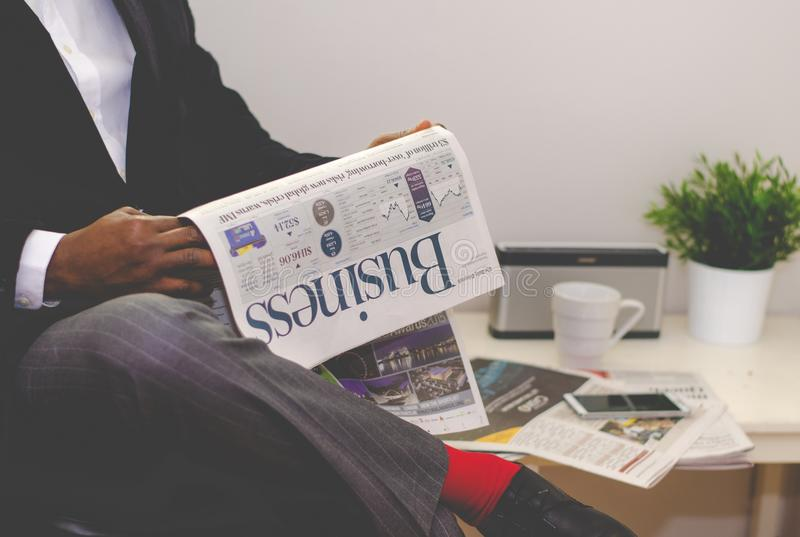 Person Holding Business Newspaper stock photos