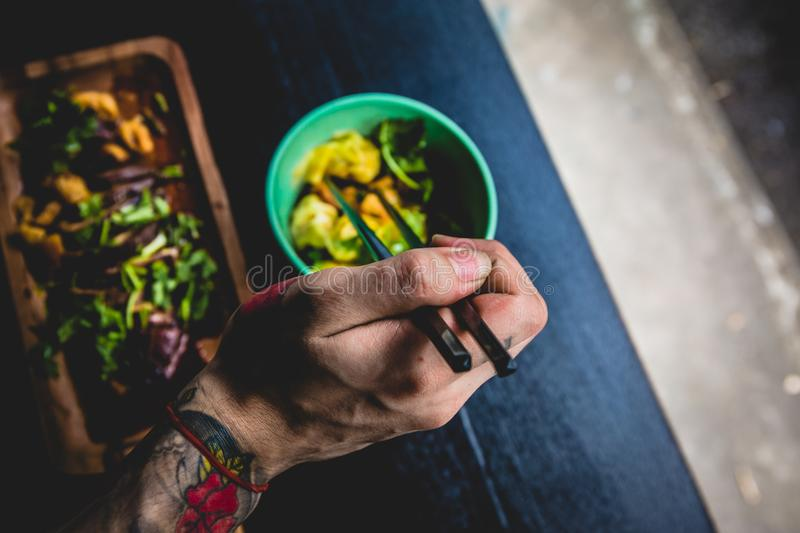 Download Person Holding Chop Stick stock image. Image of free - 82955313