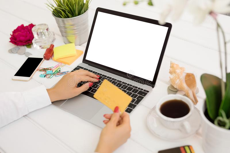 Person holding credit card in front of computer stock images