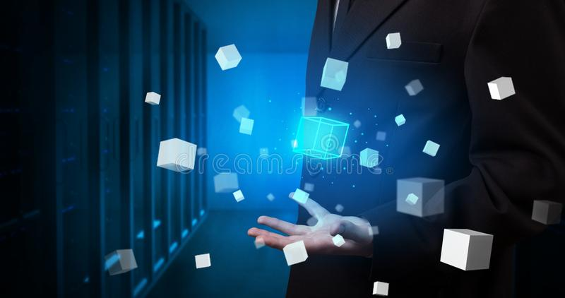 Person holding cube hologram projections. Person holding hologram projection displaying white cubes in server room stock photography