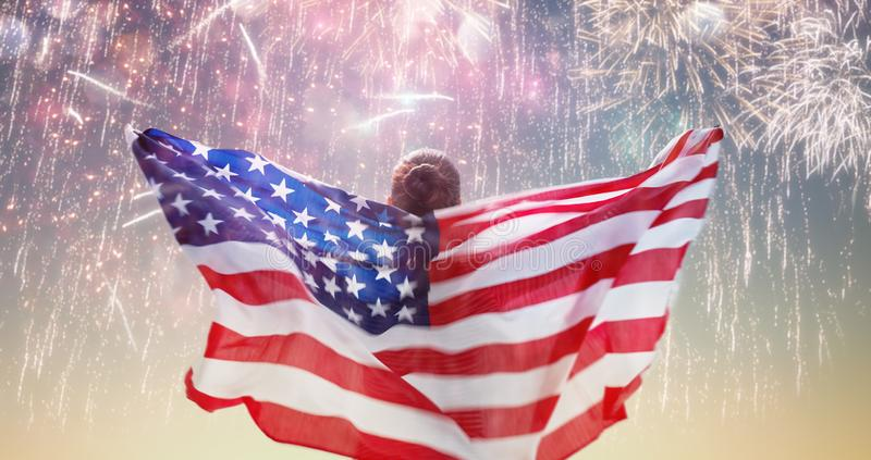 Person holding the Flag of the USA stock images