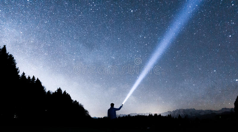 Person Holding Flashlight Towards Sky During Night Free Public Domain Cc0 Image
