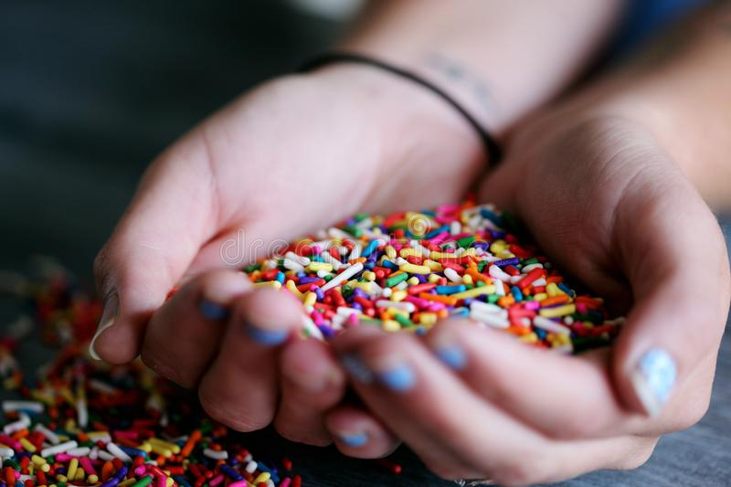 Person Holding Full of Sprinkles royalty free stock image