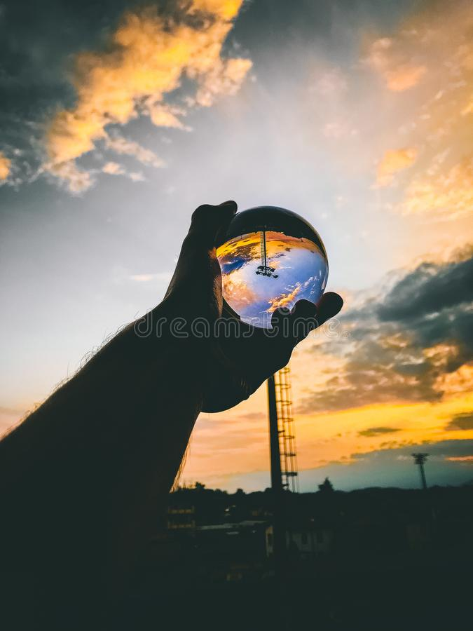 Person Holding Glass Ball royalty free stock image