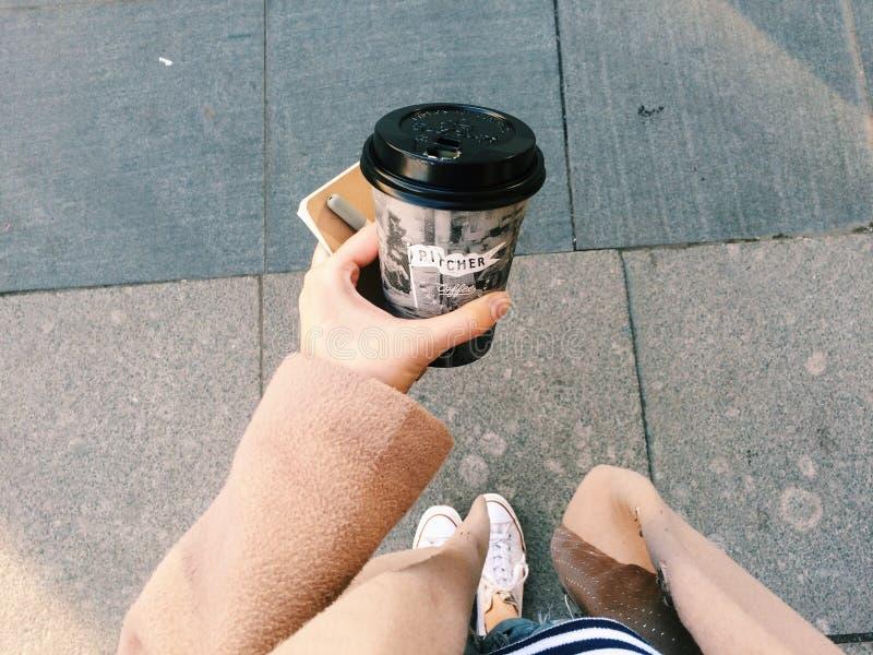 Person Holding Gray Disposable Cup stock photos