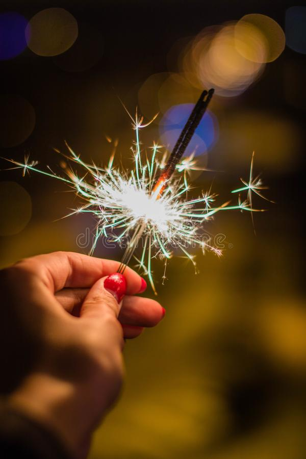 Person Holding Gray Firework royalty free stock photography