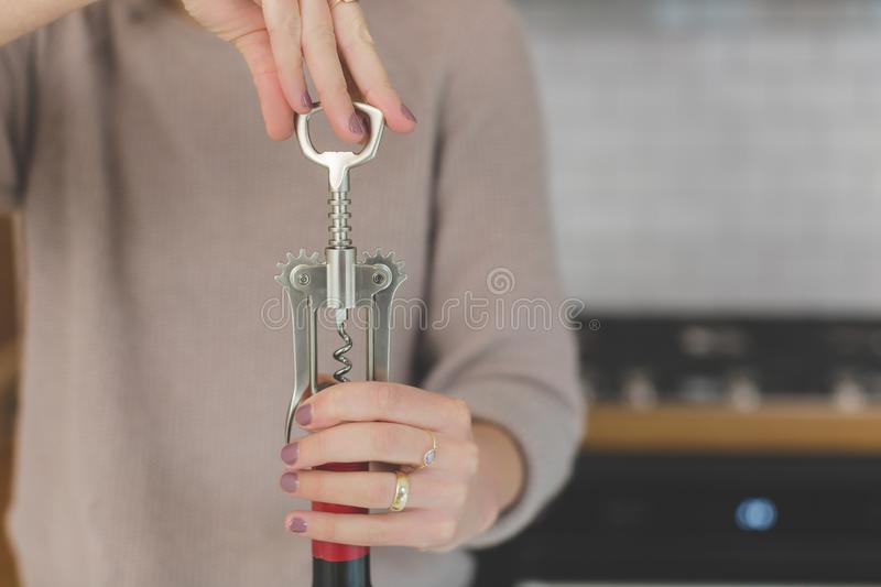 Person Holding Grey and Red Hand Tool royalty free stock photos