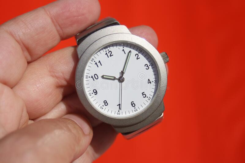 Person Holding Grey Round Analog Watch At 10:07 Free Public Domain Cc0 Image