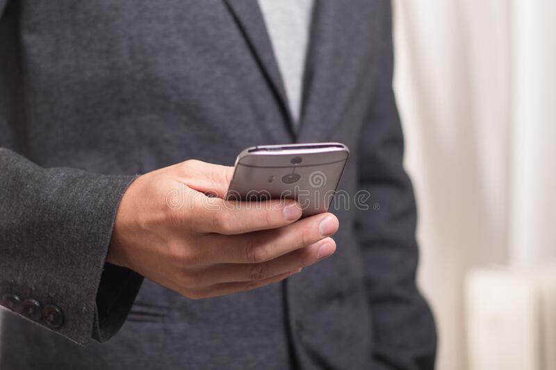 Person Holding Grey Smartphone royalty free stock photo