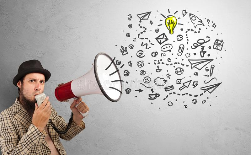 Person speaking in loudspeaker with ideas concept stock image