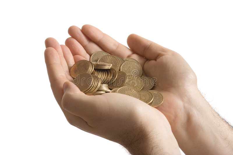 Person holding money. Person holding a lot of coins in his two hands royalty free stock photos