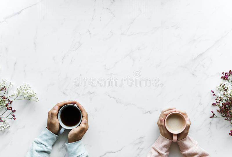 Person Holding Mug on Table stock photography