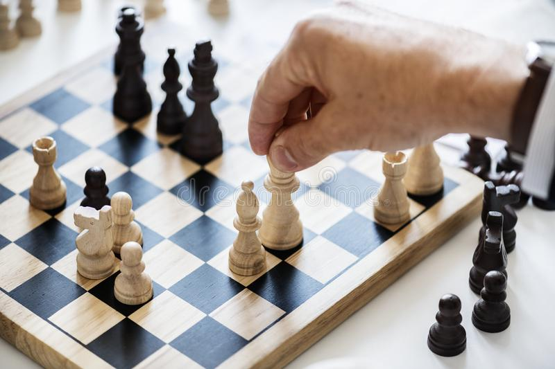 Person Holding Queen Chess Piece stock images