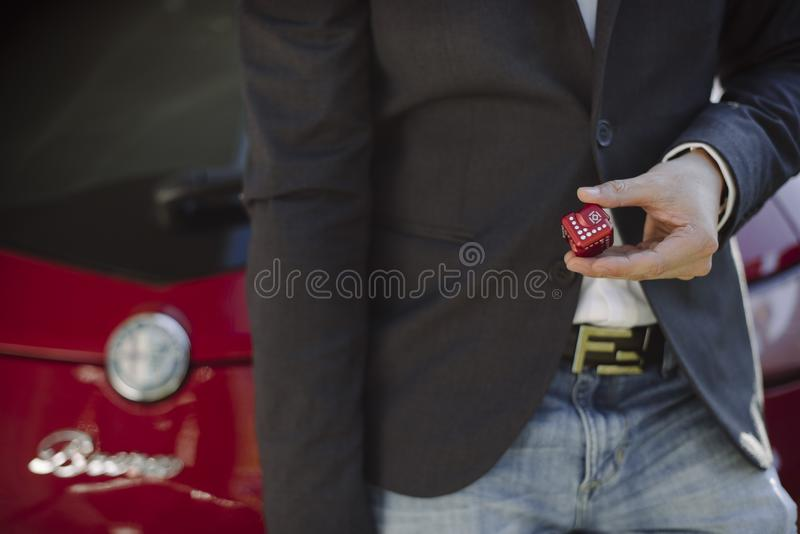 Person Holding Red Cube royalty free stock photo